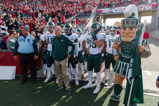 Oct 12, 2019; Madison, WI, USA; Michigan State Spartans head coach Mark Dantonio stands with the team before entering the field prior to the game against the Wisconsin Badgers at Camp Randall Stadium. Mandatory Credit: Jeff Hanisch-USA TODAY Sports
