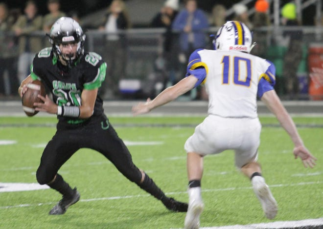 Clear Fork quarterback Brennan South looks to shake an Ontario defender in Friday night's game.