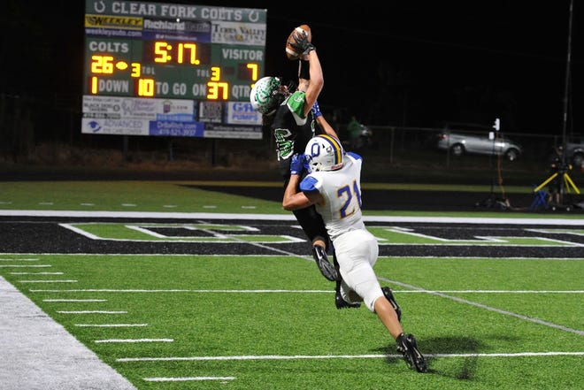 Clear Fork's Ashton Lyon goes up and over an Ontario defender for the catch during the Colts' big win over the Warriors last week.