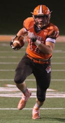 Mansfield Senior's Clay Caudill rumbles for a first down during the Tygers' win over Ashland last week.