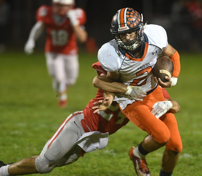 Isaiah Alsip tries to break a tackle at Shelby High School.