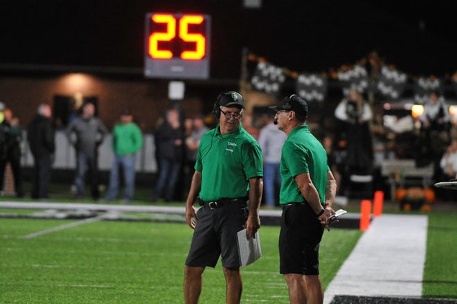 Clear Fork defensive coordinator Mike Carroll talks with his brother, Clear Fork head coach Dave Carroll, during a game in 2019 at the Colt Corral.