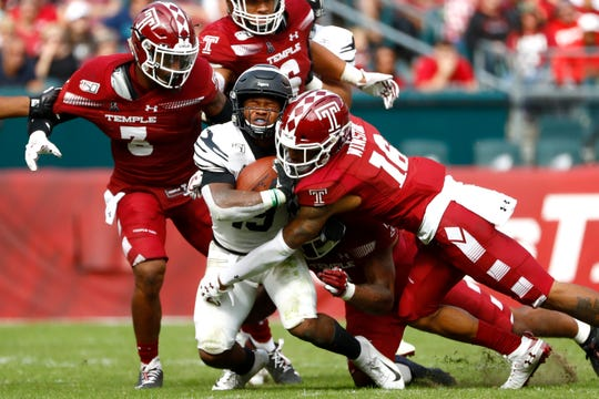 Memphis Tigers running back Kenneth Gainwell is brought down by a host of Temple Owls defenders including Chapelle Russell (3) and DaeSean Winston (16) during their game at Lincoln Financial Field in Philadelphia, Pa. on Saturday, October 12, 2019.