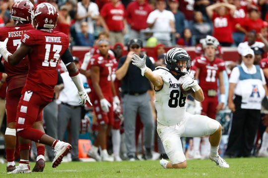 Memphis Tigers tight end Joey Magnifico signals his own first down after making, what was initially called a catch, late in the fourth quarter against the Temple Owls at Lincoln Financial Field in Philadelphia, Pa. on Saturday, October 12, 2019. The play was later reversed, effectively ending the Tiger's comeback chances.