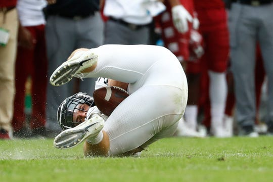 Memphis Tigers tight end Joey Magnifico traps the ball between his legs on what was initially called a catch late in the fourth quarter against the Temple Owls at Lincoln Financial Field in Philadelphia, Pa. on Saturday, October 12, 2019. The play was later reversed, effectively ending the Tiger's comeback chances.