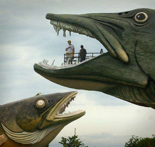 Visitors look out from the mouth of the 140-foot muskellunge at the National Fresh Water Fishing Hall of Fame and Museum in Hayward.