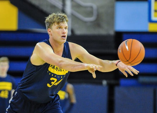 Jayce Johnson makes a pass during a Marquette practice.