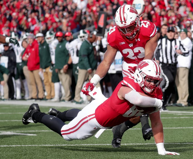Tight end Jack Ferguson's 27-yard reception on fourth-and-2 to Michigan State's 1-yard line set up the the Badgers' first touchdown in the first quarter.