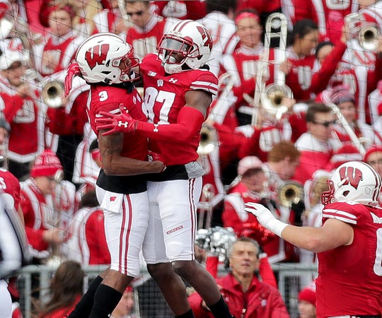 Wisconsin Badgers wide receivers Quintez Cephus (87) and Kendric Pryor celebrate Cephus' touchdown catch during the first half Saturday against Michigan State at Camp Randall Stadium in Madison.