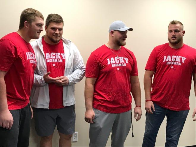 "Wisconsin Badgers offensive linemen, from left, Logan Bruss, Jason Erdmann, Tyler Biadasz and David Moorman sport ""Jacky Heisman"" shirts Saturday in honor of quarterback Jack Coan."