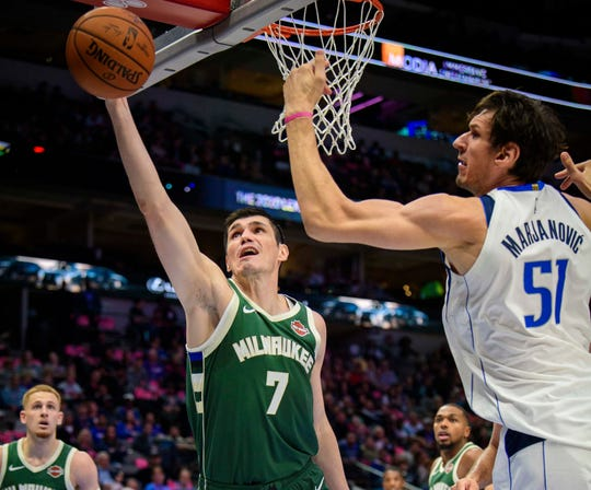 Bucks forward Ersan Ilyasova grabs a rebound during the second half against the Mavericks at the American Airlines on Friday.