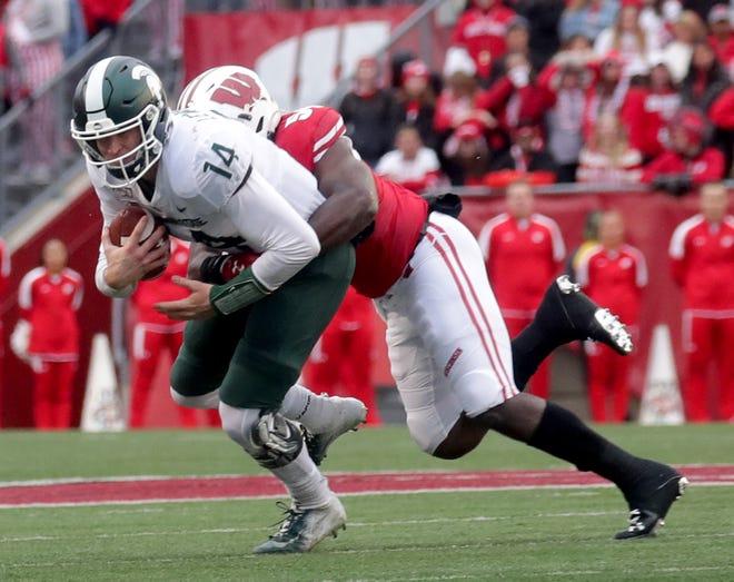 Badgers inside linebacker Chris Orr sacks Michigan State quarterback Brian Lewerke during the third quarter.