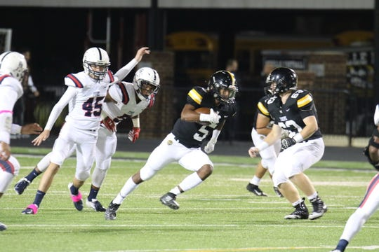 Max Hunter (5) runs past Franklin Parish defenders in Neville 41-0 homecoming win at Bill Ruple Stadium. Hunter led the Tigers with nine carries for 102 yards.