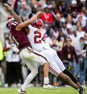 Alabama linebacker Terrell Lewis (24) hits Texas A&M quarterback Kellen Mond (11) as he releases the ball at Kyle Field in College Station, Texas on Saturday October 12, 2019.
