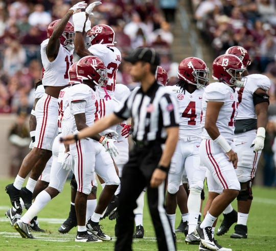Alabama defensive backs Xavier McKinney (15) and Josh Jobe (28) celebrate McKinney's fumble recovery against Texas A&M at Kyle Field in College Station, Texas on Saturday October 12, 2019.