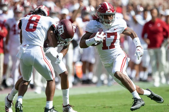 Alabama wide receiver Jaylen Waddle (17) scores a touchdown against Texas A&M at Kyle Field in College Station, Texas on Saturday October 12, 2019.