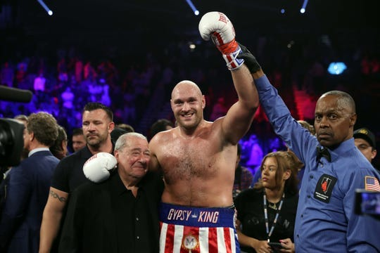 Tyson Fury celebrates after defeating Tom Schwarz.