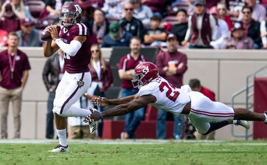 Texas A&M quarterback Kellen Mond (11) eludes Alabama linebacker Terrell Lewis (24) at Kyle Field in College Station, Texas on Saturday October 12, 2019.