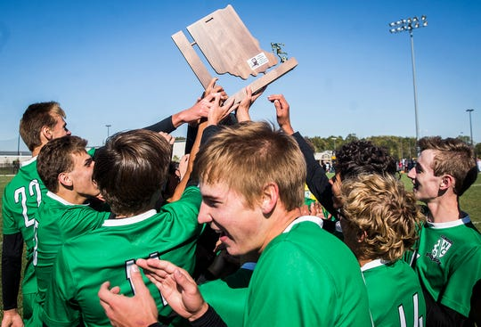 New Castle celebrates defeating Yorktown at the Yorktown Sports Park Saturday, Oct. 12, 2019.