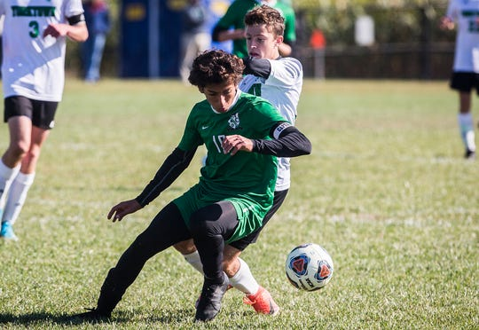 New Castle's Eddy Yousak makes a move past a Yorktown defender in their sectional championship game at the Yorktown Sports Park Saturday, Oct. 12, 2019. New Castle beat Yorktown 1-0.