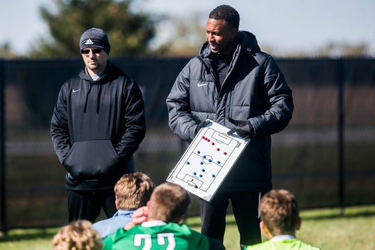 New Castle coach Tyron Rainer talks to his team at halftime during their sectional championship game against Yorktown at the Yorktown Sports Park Saturday, Oct. 12, 2019.