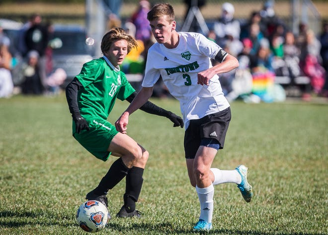 FILE -- Yorktown's Braden Guinn slips past a defender in the sectional championship game at Yorktown Sports Park Saturday, Oct. 12, 2019.