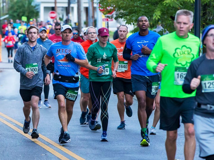 Maney Avenue is crowded with Middle Half runners going in opposite directions on Saturday, Oct. 12, 2019.