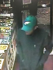 Smyrna Police are searching for a suspect in connection with an armed robbery at Gil's Market. The suspect was wearing a green Philadelphia Eagles hat.