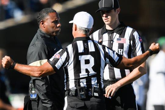 Vanderbilt head coach Derek Mason speaks with officials during the first half against UNLV at Vanderbilt Stadium in Nashville, Tenn., Saturday, Oct. 12, 2019.