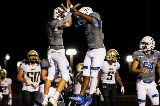 Barron Collier's Jason Grimes, center left, and Cj Addison, center right, celebrate a touchdown during their 2019 Homecoming football game on Friday, October 11, 2019, at Barron Collier High School.