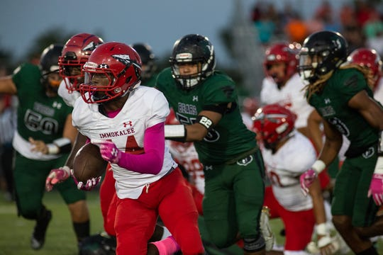 Immokale DB, Charles Toombs (14), scoops a fumble up and scores for the first touchdown of the game during Palmetto Ridge's Homecoming football game on Friday, October 11, 2019, at Palmetto Ridge High School. (Bret Munson/ Special to the Naples Daily News)