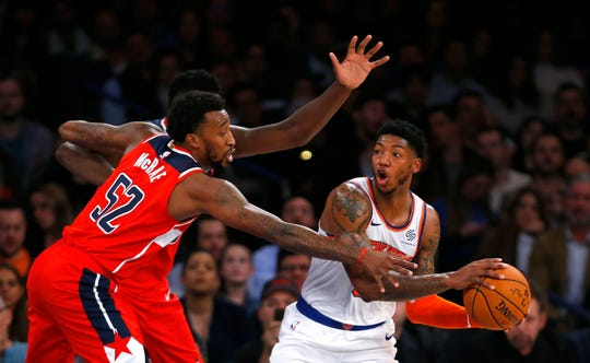 Oct 11, 2019; New York, NY, USA; New York Knicks guard Elfrid Payton (6) controls the ball against Washington Wizards guard Jordan McRae (52) during the first half at Madison Square Garden. Mandatory Credit: Noah K. Murray-USA TODAY Sports