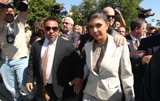Joe and Teresa Giudice leave the courthouse in 2013.