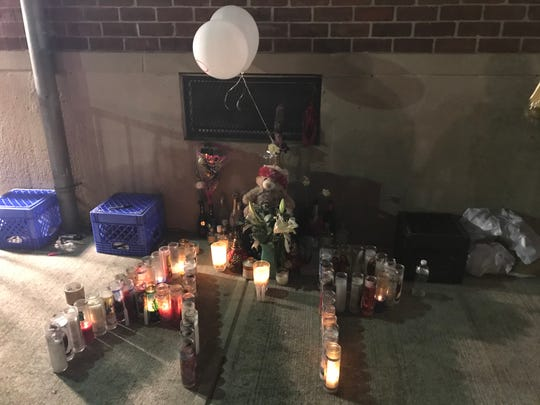 A memorial set up for Amir Pyron with his initial spelled out in candles in Passaic Oct. 11, 2019. Pyron, 22, was killed in a shooting five days earlier.