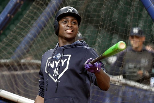 New York Yankees shortstop Didi Gregorius jokes with teammates during batting practice for a baseball American League Championship Series in Houston, Friday, Oct. 11, 2019. The Yankees are scheduled to face the Houston Astros starting Saturday.