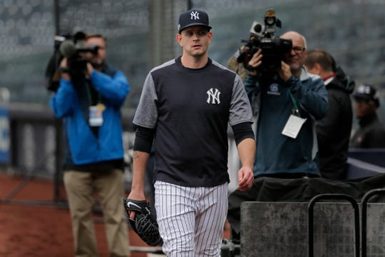 New York Yankees starting pitcher James Paxton leaves the field after throwing in a light drizzle at Yankee Stadium, Thursday, Oct. 3, 2019, in New York, the day prior to his Game 1 start of the AL Division Series.