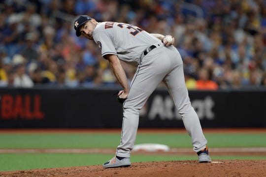 Houston Astros' Justin Verlander checks a Tampa Bay Rays runner during Game 4 of a baseball American League Division Series Wednesday, Oct. 9, 2019, in St. Petersburg, Fla.