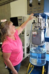 Shari Avent is part of the LCU workforce. She works in the Natural Gas Operations and Maintenance Line of Business at LCU; here she demonstrates gas meter testing.