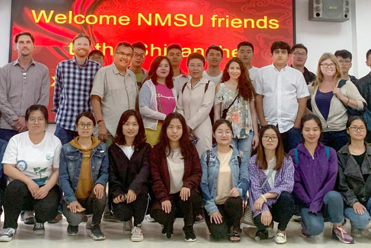 New Mexico State University graduate students Emily Creegan, Esmaiil Mokari, Curt Pierce, Jeremy Schallner and Shanelle Trail; and NMSU associate professor Dave Dubois among Chinese students and faculty at the China Agricultural University in Beijing.