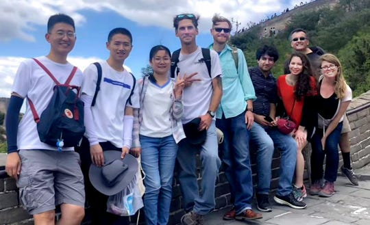 New Mexico State University graduate students, from right, Emily Creegan, Shanelle Trail, Esmaiil Mokari, Jeremy Schallner and Curt Pierce with three Chinese students at the Great Wall of China.
