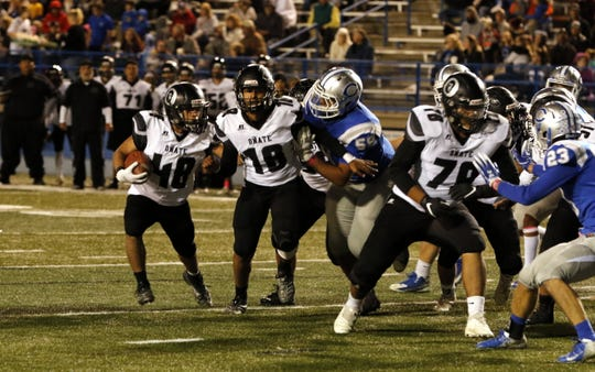 Oñate running back Alexandro Lara runs for a touchdown during their Week 7 game against Carlsbad on Oct. 11, 2019.