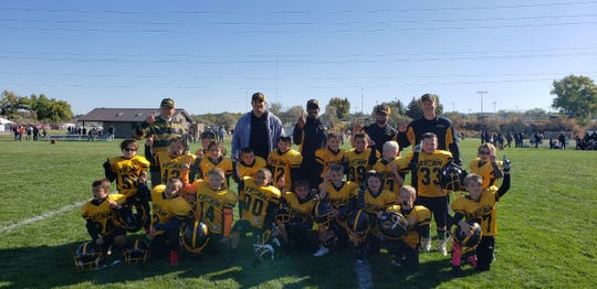 The Farmington Storm second grade football team finished the 2019 Young America Football League season undefeated at 7-0 after holding off Aztec for an 8-0 victory Oct. 12 at Aztec YAFL Field.