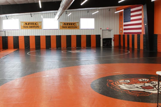 The Aztec wrestling team unveiled its new 5,000 square-foot training facility to the public on Saturday.