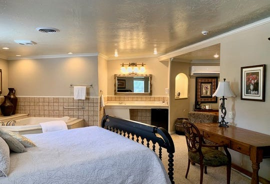The era atmosphere is retained in one of two suites at Tinnie Silver Dollar that can be rented nightly