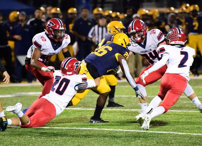 Franklin defenders try and bring down Fordson running back KeyShawn Smith. Livonia Franklin lost its first game to Dearborn Fordson 33-21.