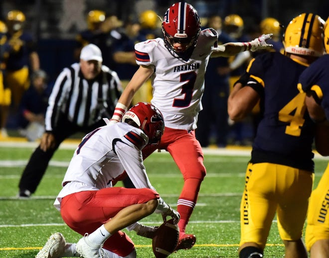 Frankin kicker Connor McIntosh connects on an extra point. Livonia Franklin lost its first game to Dearborn Fordson 33-21.