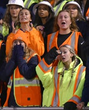 South Lyon High fans react to seeing Walled Lake Western's Abdur-Rahmaan Yaseen score the first of many Walled Lake Western High first half touchdowns against their team.