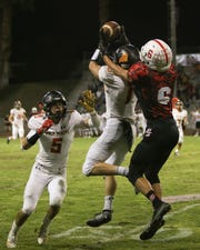 Palm Desert's Joshua McIlroy (1) makes a key first-half interception against Palm Springs on Friday.