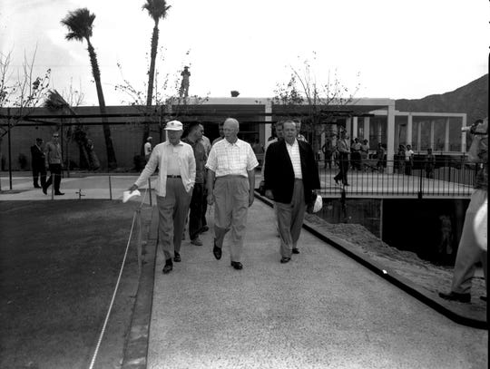 President Dwight D. Eisenhower and friends pictured in front of the palatial Eldorado Country Club entrance.