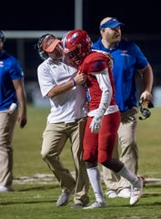 Head coach Jason McDonald congratulates Dacarrion Mcwilliams (5) after making an interception during the West Florida vs Pine Forest football game. The Eagles captured a District 1-5A title on Tuesday with a win at Choctaw.